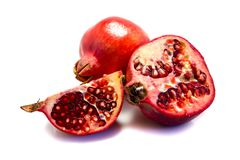 A whole and a half pomegranate isolated on white background royalty free stock images