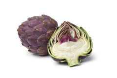 Whole and half purple artichoke Stock Photo