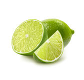 Whole, half and quarter piece lime isolated on white Royalty Free Stock Photography