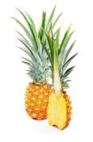 Whole and half ripe pineapple Royalty Free Stock Photography