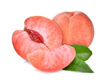 Whole and half with slice of peach with green leaves isolated royalty free stock photos