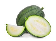 Whole and half with slice of young small green watermelon Royalty Free Stock Photos