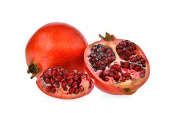 Whole and half with slices pomegranate fruit isolated on white. Background Royalty Free Stock Photos