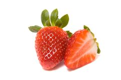 The whole and half strawberry. Isolated on white background Stock Photography