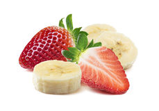 Whole and half strawberry, banana pieces square composition isolated royalty free stock photos
