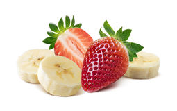 Whole and half strawberry, banana pieces on white backg stock image