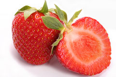 Whole and half strawberry. Whole and half ripe strawberry Royalty Free Stock Photo