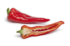 Whole and half sweet red bell  peppers Stock Images
