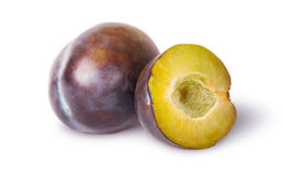 Whole and half of violet plums near Stock Image