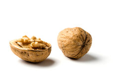Whole and half walnut isolated Stock Images