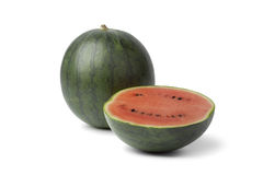 Whole and half watermelon Royalty Free Stock Image