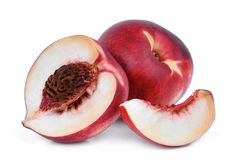 Whole and half wiht slice of nectarine fruit isolated on whitie Royalty Free Stock Photography