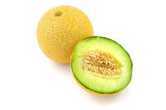 Whole and half yellow melon Stock Photos