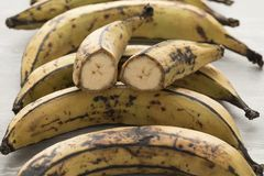 Whole and half yellow plantains Stock Photography
