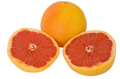 Whole and halve Pink Grapefruit Stock Image