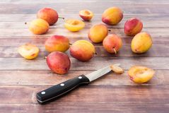 British Victoria Plums on Brown Wood Panel Background royalty free stock photo