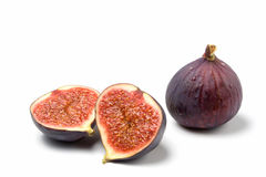 Whole and halved fig isolated Royalty Free Stock Images