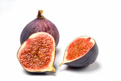 Whole and halved fig isolated Stock Image