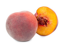 Whole and halved fresh peach Royalty Free Stock Images