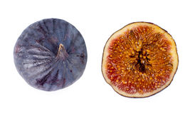 Whole and halved fresh purple fig Royalty Free Stock Photos