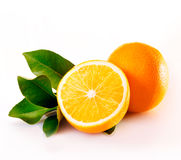 Whole and halved juicy orange Royalty Free Stock Images