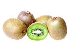 Whole and halved kiwi fruits Royalty Free Stock Photography