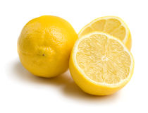 Whole and halved lemons Stock Image