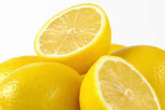 Whole and halved lemons Royalty Free Stock Photos