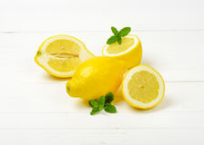 Whole and halved lemons Royalty Free Stock Images