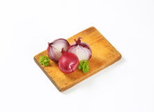 Whole and halved red onions Stock Photo