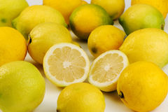 Whole and halved ripe lemons Stock Photo