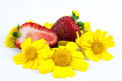 Strawberries and yellow flowers Stock Photography