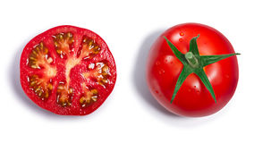 Whole and halved Tomatoes, top view, paths Royalty Free Stock Images