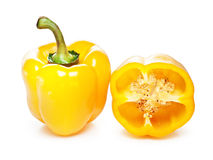Whole and halved yellow pepper Royalty Free Stock Photo