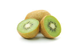 Whole and halves kiwi Royalty Free Stock Images