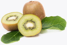 Whole and halves kiwi. Royalty Free Stock Photos