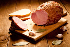 Whole ham with bread Stock Photography