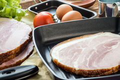Whole ham with tomato and eggs in the background Stock Photography