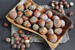 Whole hazelnuts and shelled hazelnuts Royalty Free Stock Photo