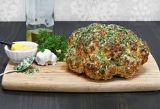 Whole head of roasted cauliflower. Stock Photos