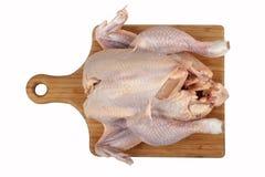 Whole hen on board Stock Photo
