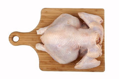 Whole hen on board Royalty Free Stock Photos