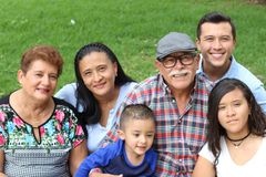 Whole Hispanic real looking family stock photos