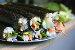Whole homemade sushi rolls stock photography