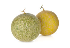 Whole honeydew and galia melon with stem on white Stock Images