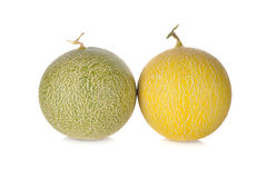Whole honeydew and galia melon with stem on white Royalty Free Stock Images