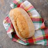 Whole italian bread on napkin Royalty Free Stock Photo