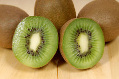 Whole kiwi fruit and his segments Royalty Free Stock Photos