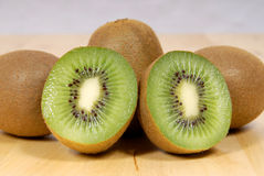 Whole kiwi fruit and his segments Stock Image