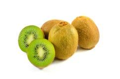 Whole kiwi fruit and his sliced segments isolated Stock Photography